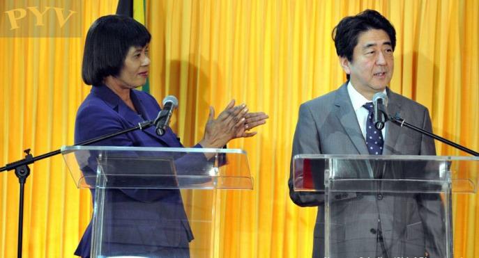 Jamaica's Prime Minister Portia Simpson Miller and Shinzo Abe, prime minister of Japan, held bilateral talks
